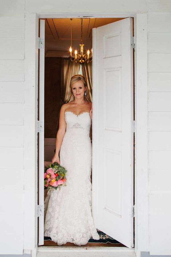 Real bride in gorgeous lace dress in doorway