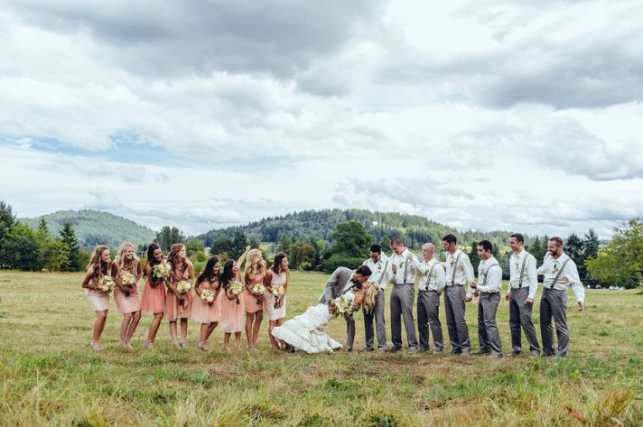 Bridal party pic with kiss