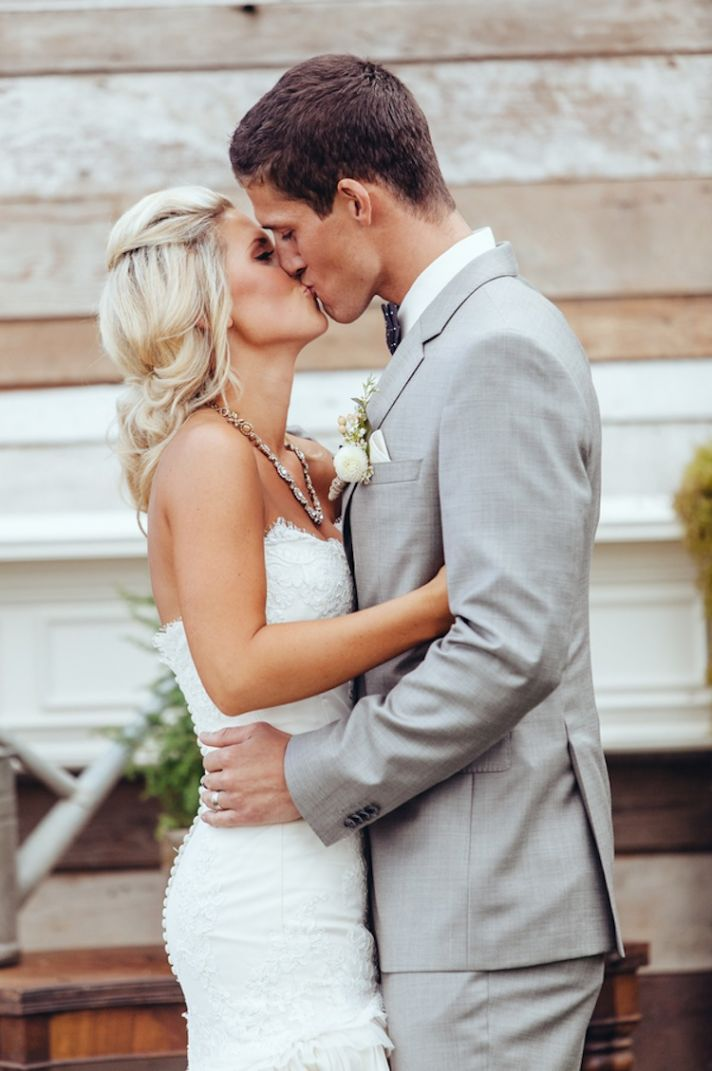 Ceremony kiss at an outdoor real wedding