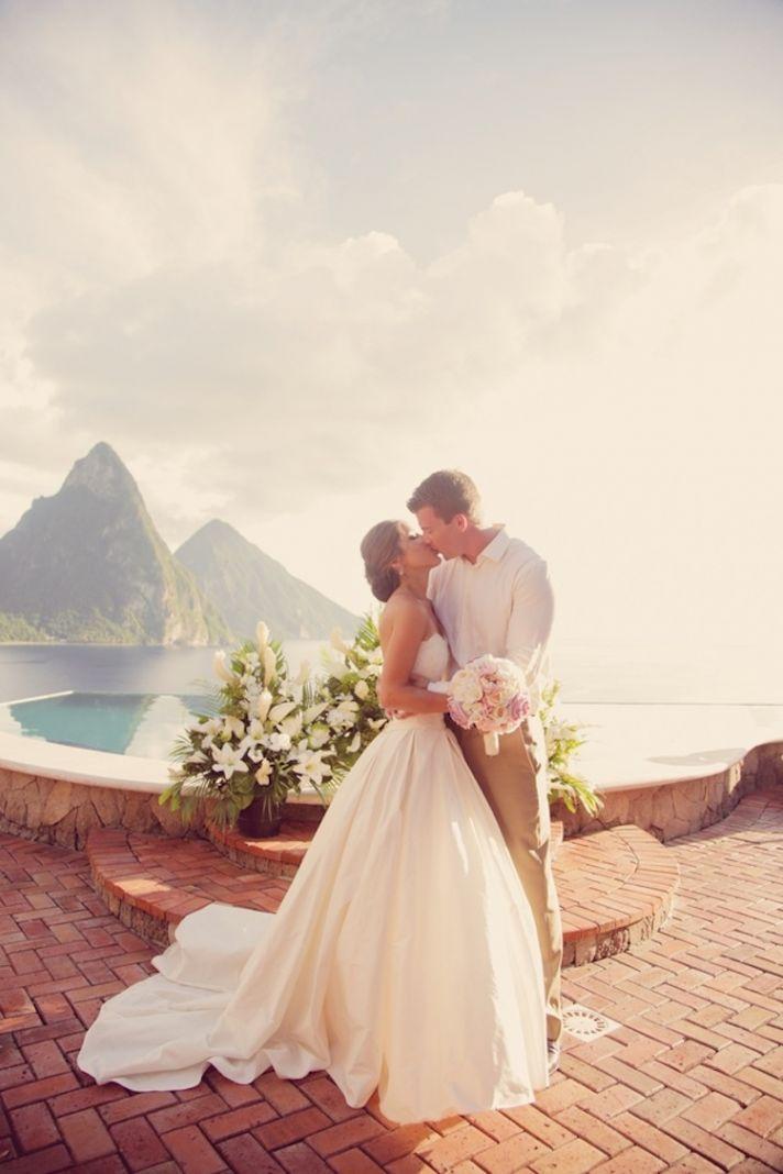 Destination wedding ceremony kiss