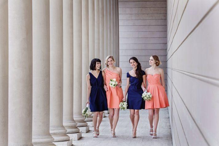 Midnight blue and peach bridesmaids dresses by Weddington Way