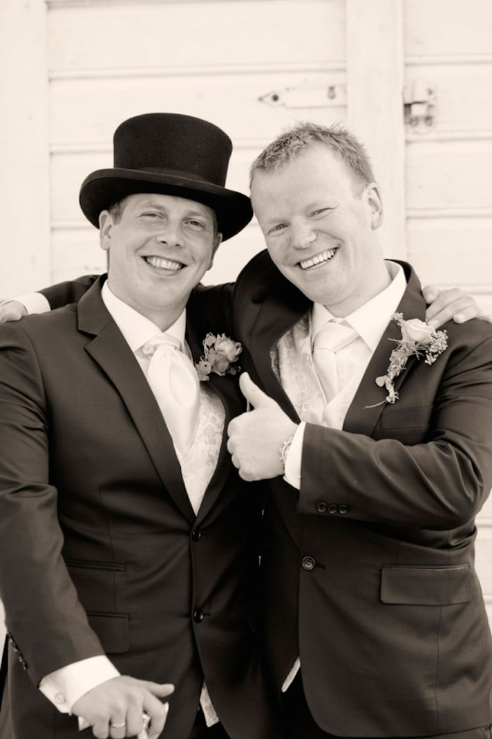 Groom in a top hat with his best man