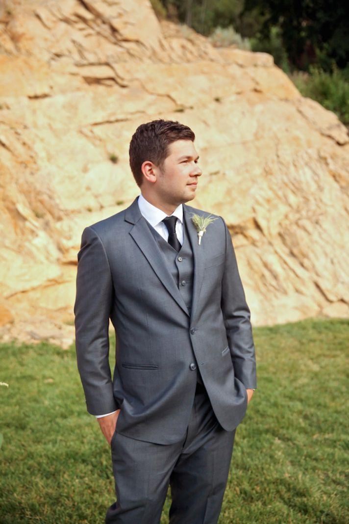 Groom in a classic grey tuxedo