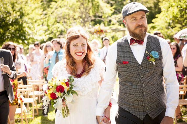 Newly married couple walk the aisle