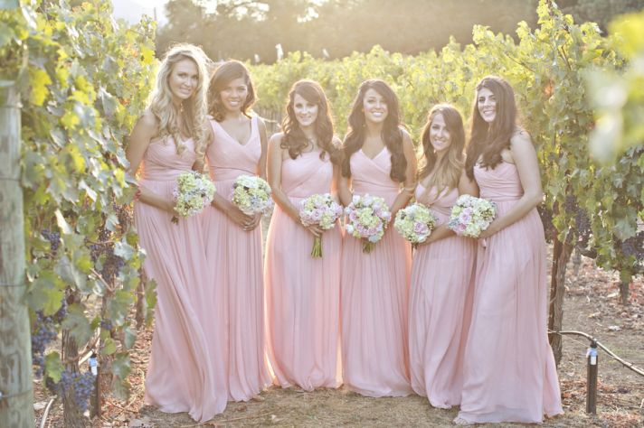 Pink bridesmaids dresses for a winery wedding