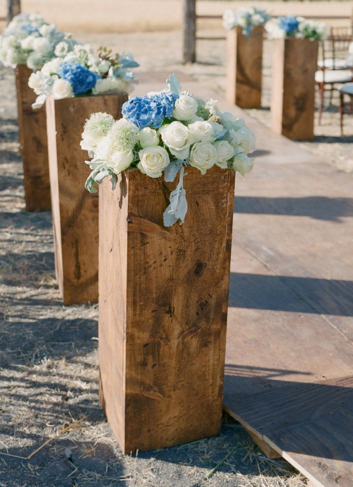 Blocks of Wood Topped with Flowers for Aisle Decor