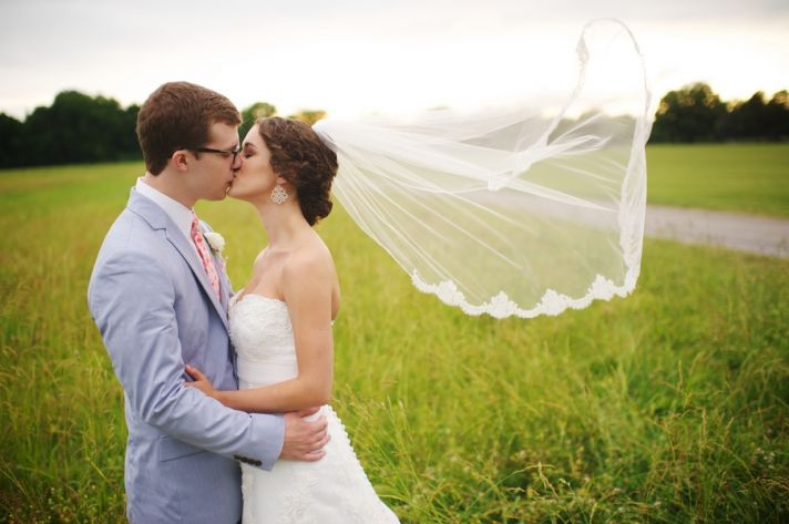 Lace Trimmed Veil Flowing In the Breeze